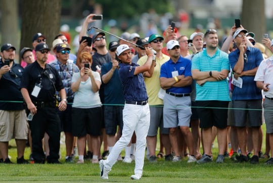 Rickie Fowler hits his approach on the sixth hole during the first round of the 2019 Rocket Mortgage Classic.