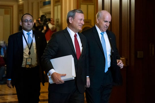 Chief Justice of the United States John Roberts arrives at the Senate to preside at the impeachment trial of President Donald Trump on charges of abuse of power and obstruction of Congress, at the Capitol in Washington, Thursday, Jan. 16, 2020. He is escorted by Sergeant-at-Arms Michael Stenger, right.