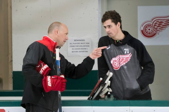 Red Wings head coach Jeff Blashill, left, has the support of forward Dylan Larkin (right).