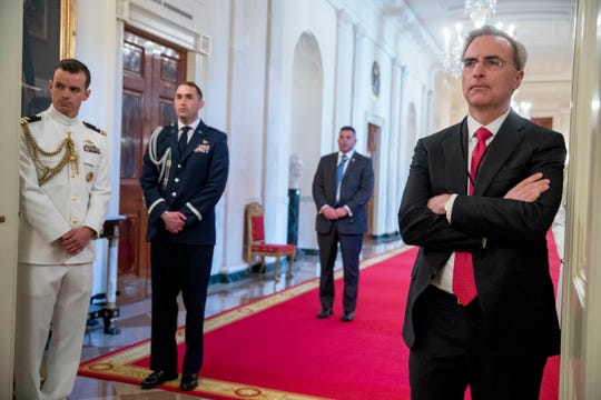 FILE - In this May 22, 2019, file photo, White House Counsel Pat Cipollone, right, attends a Public Safety Officer Medal of Valor presentation ceremony in the East Room of the White House in Washington.