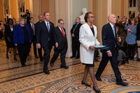 House Sergeant at Arms Paul Irving and Clerk of the House Cheryl Johnson carry the articles of impeachment against President Donald Trump to Secretary of the Senate Julie Adams on Capitol Hill in Washington, Wednesday, Jan. 15, 2020. Following are impeachment managers, House Judiciary Committee Chairman, Rep. Jerrold Nadler, D-N.Y., House Intelligence Committee Chairman Adam Schiff, D-Calif., Rep. Hakeem Jeffries, D-N.Y., Rep. Sylvia Garcia, D-Texas, Rep. Val Demings, D-Fla., Rep. Zoe Lofgren, D-Calif., and Rep. Jason Crow, D-Colo.