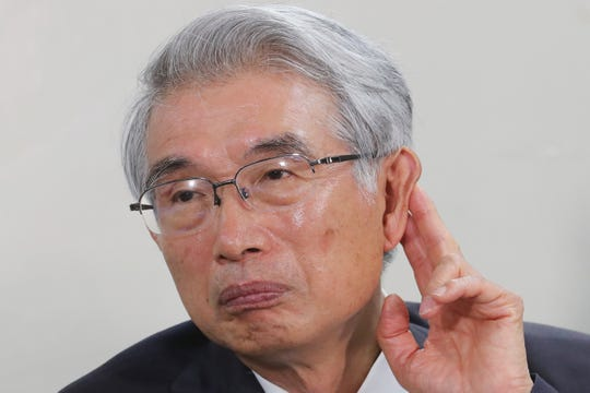 FILE - In this Oct. 24, 2019, file photo, Junichiro Hironaka, a lawyer of former Nissan Chairman Carlos Ghosn, attends a press conference in Tokyo.
