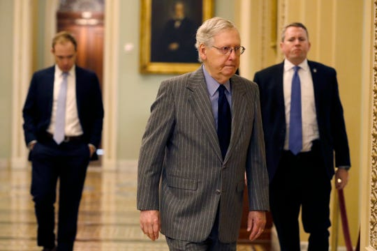 Senate Majority Leader Mitch McConnell, R-Ky., arrives at the Capitol, in Washington, Wednesday, Jan. 15, 2020.