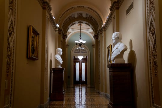 The entrance to the Senate cloakroom at the Capitol is seen in Washington, early Wednesday, Jan. 15, 2020, as the House is set to vote to send the articles of impeachment against President Donald Trump to the Senate for a landmark trial on whether the charges of abuse of power and obstruction of Congress are grounds for his removal.