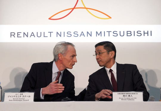 In this March 12, 2019, file photo, Renault Chairman Jean-Dominique Senard, left, and Nissan CEO Hiroto Saikawa speak at the start of a joint press conference.