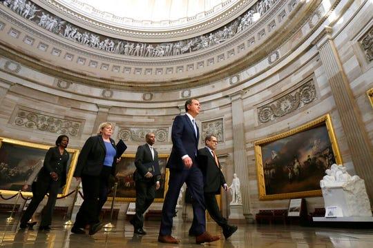 From left, Rep. Val Demings, D-Fla., Rep. Rep. Zoe Lofgren, D-Calif.,  Rep. Hakeem Jeffries, D-N.Y.,  House Intelligence Committee Chairman Adam Schiff, D-Calif., and House Judiciary Committee Chairman, Rep. Jerrold Nadler, D-N.Y., walk to the Senate on Capitol Hill in Washington, Thursday, Jan. 16, 2020.