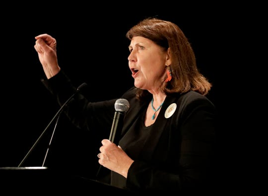 FILE - IN this Nov. 8, 2016 file photo, Democratic senatorial candidate U.S. Rep. Ann Kirkpatrick, D-Ariz., speaks to supporters during an election night party in Phoenix.