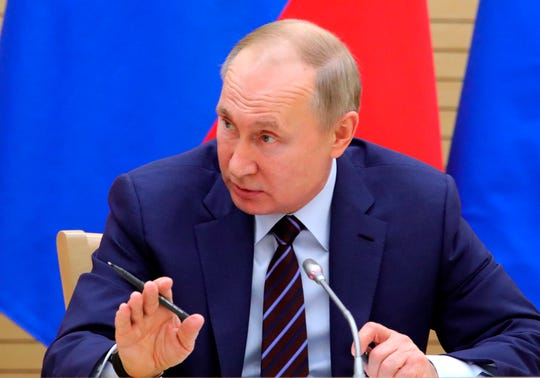 Russian President Vladimir Putin speaks as he chairs a meeting on drafting constitutional changes at the Novo-Ogaryovo residence outside Moscow on Thursday.