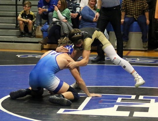Corning's Drew Witham (top) takes on Horseheads' Calem Houper in a 132-pound match Jan. 15, 2020 at Horseheads High School.