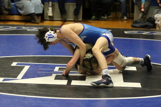 Tommy Dale of Horseheads (top) takes on Corning's Taylor Allyn in a 113-pound match Jan. 15, 2020 at Horseheads High School.