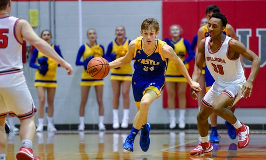 Castle's Zeke Niehaus (24) picks up a loose ball as the Castle Knights play the Bosse Bulldogs in the first round of the boys Southern Indiana Athletic Conference tournament at Bosse Tuesday evening, January 14, 2020.