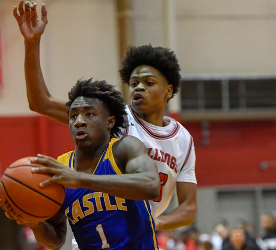 Castle's Isaiah Swope (1) drives past Bosse's Julian Norris (23) as the Castle Knights play the Bosse Bulldogs in the first round of the boys Southern Indiana Athletic Conference tournament at Bosse Tuesday evening, January 14, 2020.