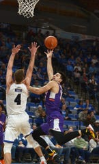 Evansville's Sam Cunliffe shoots an off-balance shot and misses in the first half of the Purple Aces' game against the host Indiana State Sycamores on Wednesday.
