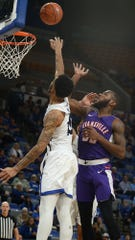 Evansville's John Hall shoots over several Indiana State defenders in the first half of the Purple Aces' game against the host Sycamores on Wednesday in Terre Haute.