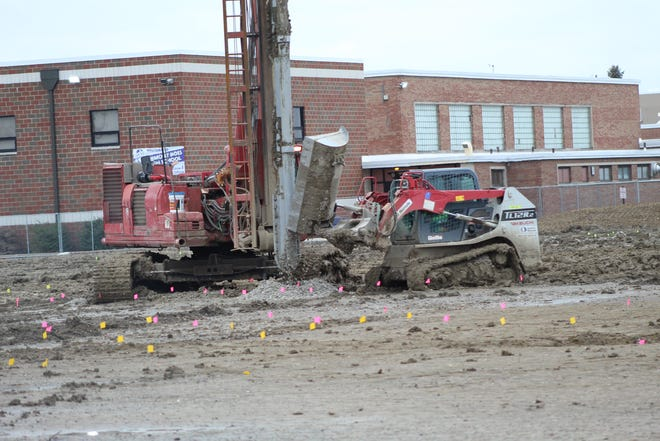 Work continued Thursday on the new Fremont Ross High School as crews began digging holes to prepare for construction of the school building. The school board in October approved a $49.5 guaranteed maximum price for construction the new school, which is being built next to the existing Ross High. Construction is scheduled to be completed in August 2021.