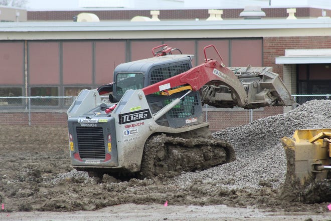 Work continued Thursday on the new Fremont High School as crews began boring holes in the ground.