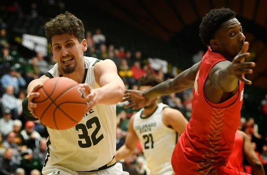 Colorado State Rams center Nico Carvacho (32) reaches for the ball in the second half of the game at Moby Arena at Colorado State University in Fort Collins, Colo. on Wednesday, January 15, 2020.