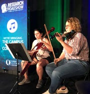 A presentation highlighting the work of FGCU's booming entrepreneur school featured musicians Lydia Coyner and Antonella Chiappo.