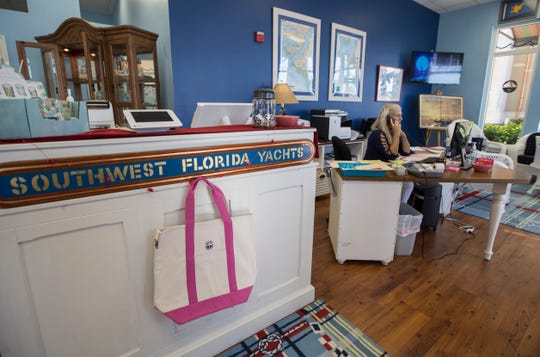 Southwest Florida Yachts reservation specialist Barbara Galasso, tends to the phone Thursday, Jan. 16, 2020. The Marina Village Shops at Tarpon Point have added monthly brunch events to allow visitors to shop, stroll and brunch their way around.