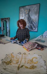 Nydia Castro, an employee at Turquoise, a fashion boutique in the Marina Village Shops at Tarpon Point, prepares garments for display, Thursday, Jan. 16, 2020. The shops have added monthly brunch events to allow visitors to shop, stroll and brunch their way around.