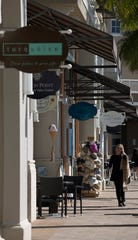 A visitor strolls along the corridor at Marina Village Shops at Tarpon Point in Cape Coral, Thursday, Jan. 16, 2020. The shops have added monthly brunch events to allow visitors to shop, stroll and brunch their way around.