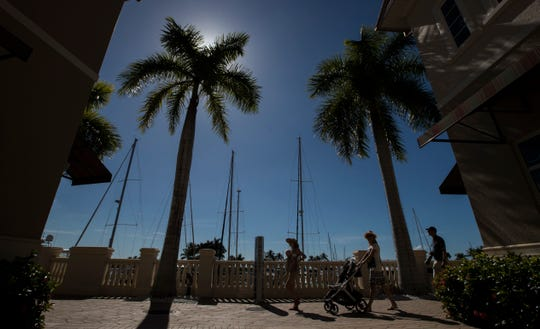 Visitors stroll along the corridor at Marina Village Shops at Tarpon Point in Cape Coral, Thursday, Jan. 16, 2020. The shops have added monthly brunch events to allow visitors to shop, stroll and brunch their way around.