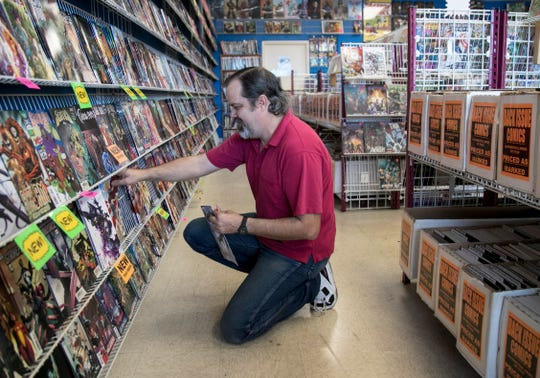 Brian Chandler puts out the week's new comics at Fort Myers Comics Cards and Stuff on Wednesday, Jan 15, 2020, in Fort Myers.
