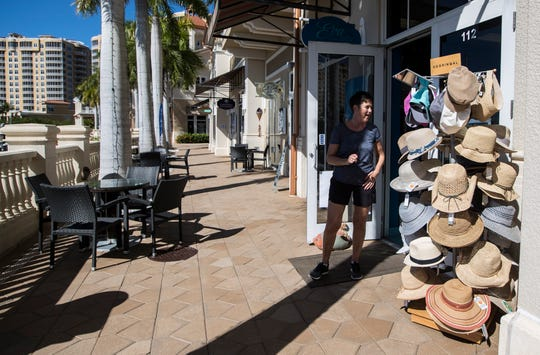 Vicky Faught, visiting from Canada, checks out the merchandise at Eva By The Sea, a fashion boutique in the Marina Village Shops at Tarpon Point, Thursday, Jan. 16, 2020. The shops have added monthly brunch events to allow visitors to shop, stroll and brunch their way around.