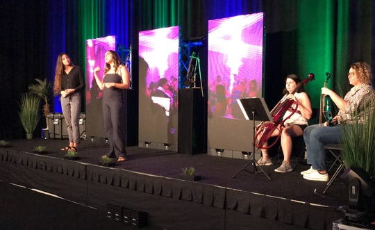 """Sisters Sapphire and Jade Gibson, left, share the growth of their business, Jade Strings, and the push they got to run their business thanks to the guidance of FGCU's booming entrepreneur school.  Their presentation, """"Marriage, Music & Money,"""" featured the help of two of their musicians – Lydia Coyner and Antonella Chiappo, at right."""