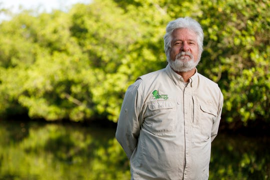 """As part of a presentation titled """"The Silence of the Frogs,"""" Professor Win Everham, shown here, and recent graduate Taylor Hancock share their experience researching Southwest Florida's frog population and how it relates to the local environment and the effects of urbanization."""