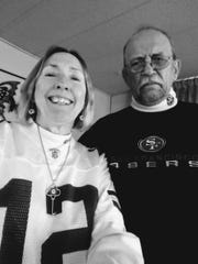 Sandra Larsen and Rick Ramirez take a picture before attending a Green Bay Packers-San Francisco 49ers game in San Francisco.