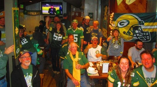 Packers fans who are members of NorCal Packers Fans gather at Third Street Aleworks in Santa Rose, Calif., to watch a game. There are Packers bars throughout California.