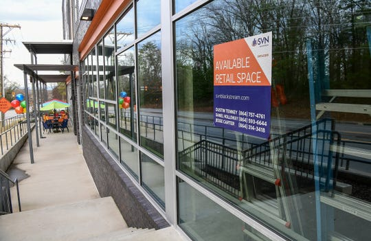 A sign reads available retail space at the Grandmarc Apartment & Condo building at 125 Anderson Highway in Clemson.