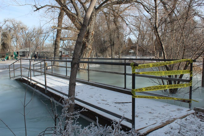 A footbridge in Choteau designed to cross Spring Creek now leads into it. Ice jams and an unusually high water table have led to flooding along the length of the stream.