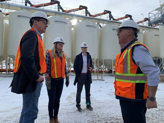Gov. Steve Bullock, left, visits Montana Craft Malt near Butte. With him are Jennifer O'Brien, the president of the facility,  Ken Fichtler, who works in the governor's office of economic development and Nabil Kasti, the plant director.