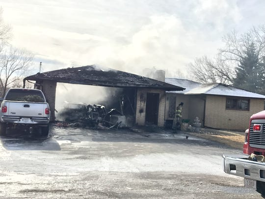 Fire rescue crews battled a garage fire south of Great Falls Thursday. Responders managed to stop the fire from spreading to most of the home, GFFR said.
