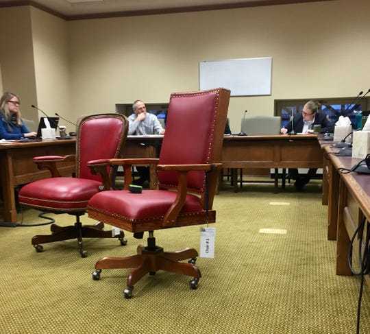 Lawmakers and some state staff review  two styles of chairs being considered for the House chambers. The chair on the left was tentatively selected Thursday.