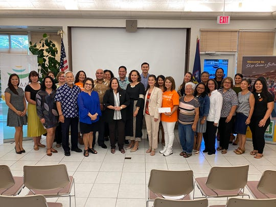 Guam Visitors Bureau, the governor and other local officials presented checks to 17 non-profit groups that will be getting money from the Tourist Attraction Fund.