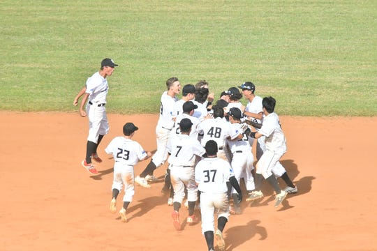 New Zealand's U-15 baseball team celebrates at second base following its 4-3, walk-off win over Guam at the WBSC U-15 Oceania Qualifier Jan. 16 at the Paseo Stadium. It was Guam's first loss of the tournament.