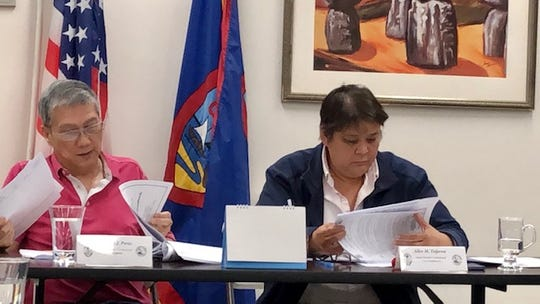 Guam Election Commission Chairman Mike Perez and Vice Chairwoman Alice Taijeron review draft copies of the 2020 candidate packets, shortly before voting to approve them during a Jan. 16, 2020 meeting. The packets will be available for pick up by Friday, Jan. 24, to give the commission time to make technical corrections.