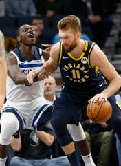 Indiana Pacers' Domantas Sabonis, right, of Lithuania, drives around Minnesota Timberwolves' Gorgui Dieng of Senegal in the first half of an NBA basketball game Wednesday, Jan. 15, 2020, in Minneapolis.