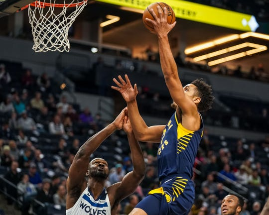 Jan 15, 2020; Minneapolis, Minnesota, USA; Indiana Pacers guard Malcolm Brogdon (7) shoots during the first quarter against the Minnesota Timberwolves at Target Center.