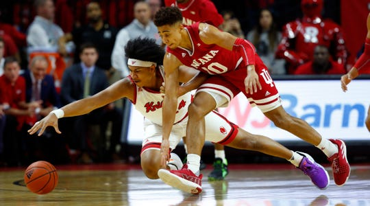 Jan 15, 2020; Piscataway, New Jersey, USA;  Rutgers Scarlet Knights guard Ron Harper Jr. (24) dives for a loose ball against Indiana Hoosiers guard Rob Phinisee (10) during the first half at Rutgers Athletic Center (RAC).