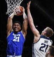 Seton Hall Pirates center Ike Obiagu (21) attempts to dunk the ball against Butler Bulldogs center Derrik Smits (21) at Hinkle Fieldhouse, Indianapolis, Wednesday, Jan. 15, 2020.