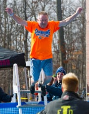 IHSAA commissioner Bobby Cox jumps into the frigid water at Butler's annual Polar Plunge, Jan. 31, 2015, where hundreds of brave souls entered the near-frozen water of a portable swimming pool for charity. Pledges of nearly $40,000 were collected for Special Olympics.