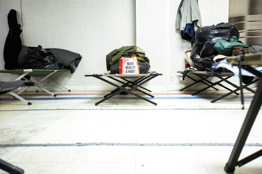 "A bag reads, ""Make health a habit"" on a cot, Wednesday, Jan. 15, 2020, at the Emergency Winter Shelter, a former Carquest Auto Parts store, along South Clinton Street in Iowa City, Iowa."