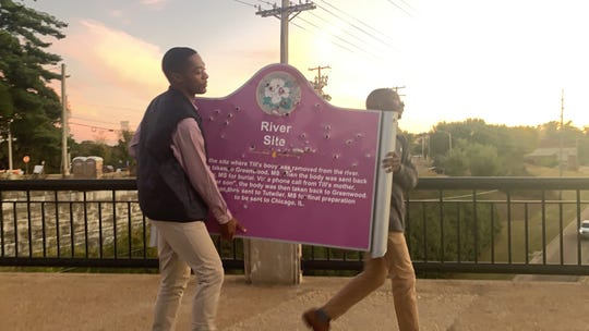 Curtis Hill, right, and his classmate carry the bullet-riddled memorial to Emmett Till on the University of Mississippi campus in October 2019.