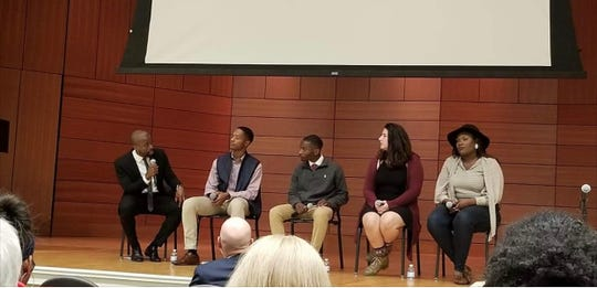 Curtis Hill, middle, joins University of Mississippi classmates and a moderator in October 2019 to talk about the need for justice in response to fellow students firing bullets at a memorial for Emmett Till, a black youth.