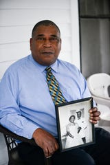 District 4 City Councilman Harvey Buchanan holds a picture of his father, James Buchanan, and his mother, Junetta Buchanan. James Buchanan was one of the three plaintiffs in the 1977 lawsuit that successfully challenged the white-controlled Jackson city government.