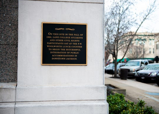 "A plaque on the Jackson City Hall building states, ""On this site in the fall of 1960, Lane College students and other civil rights participants sat at the F.W. Woolworth lunch counter to begin the successful integration of public accommodations in downtown Jackson."""